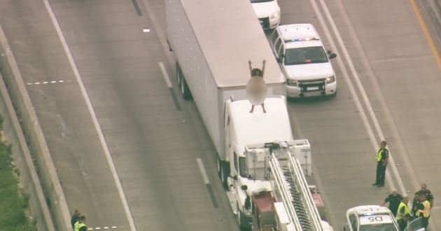 Naked woman dances on truck