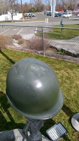 Police say someone put dents into the helmet, part of the Veterans Memorial