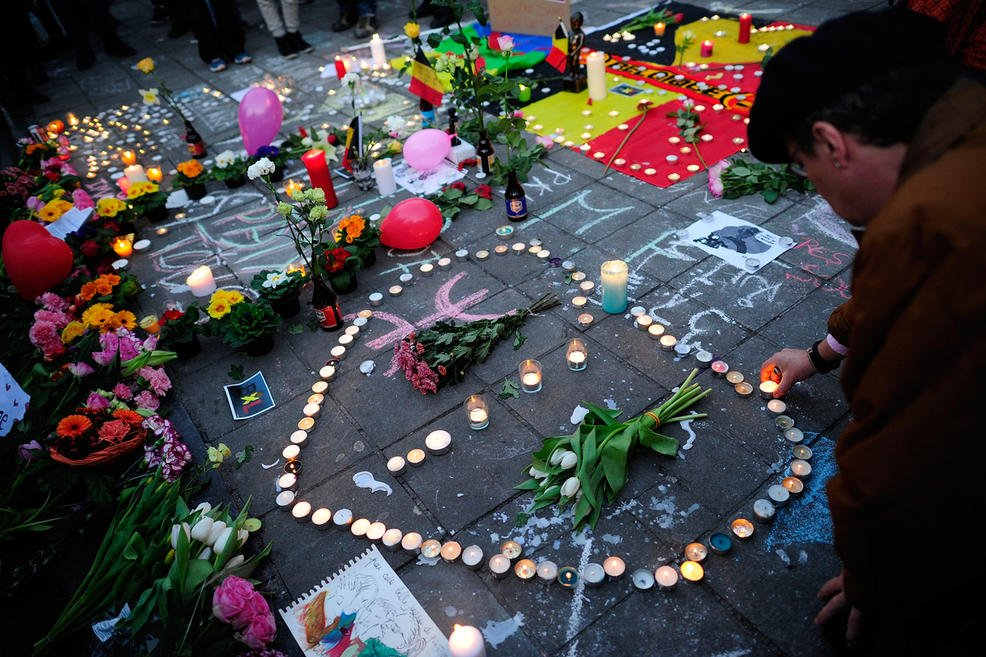 Flowers and candles are seen at Beursplein Square following three bomb blasts on March 22, 2016, in Brussels, Belgium / Getty Images