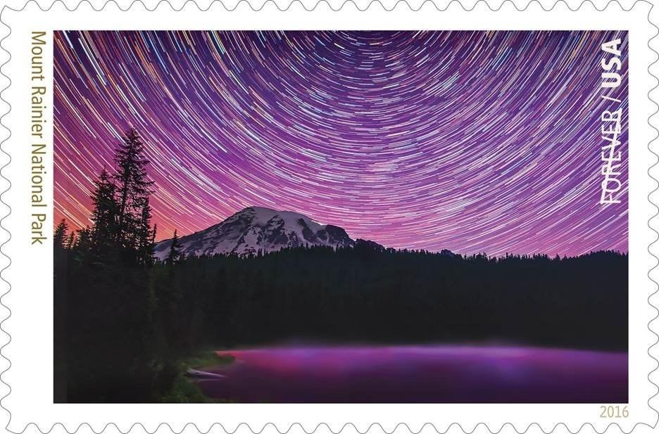 Forever Stamp showing a star field around Mount Rainier. (Credit: US Postal Service/Matt Dieterich)