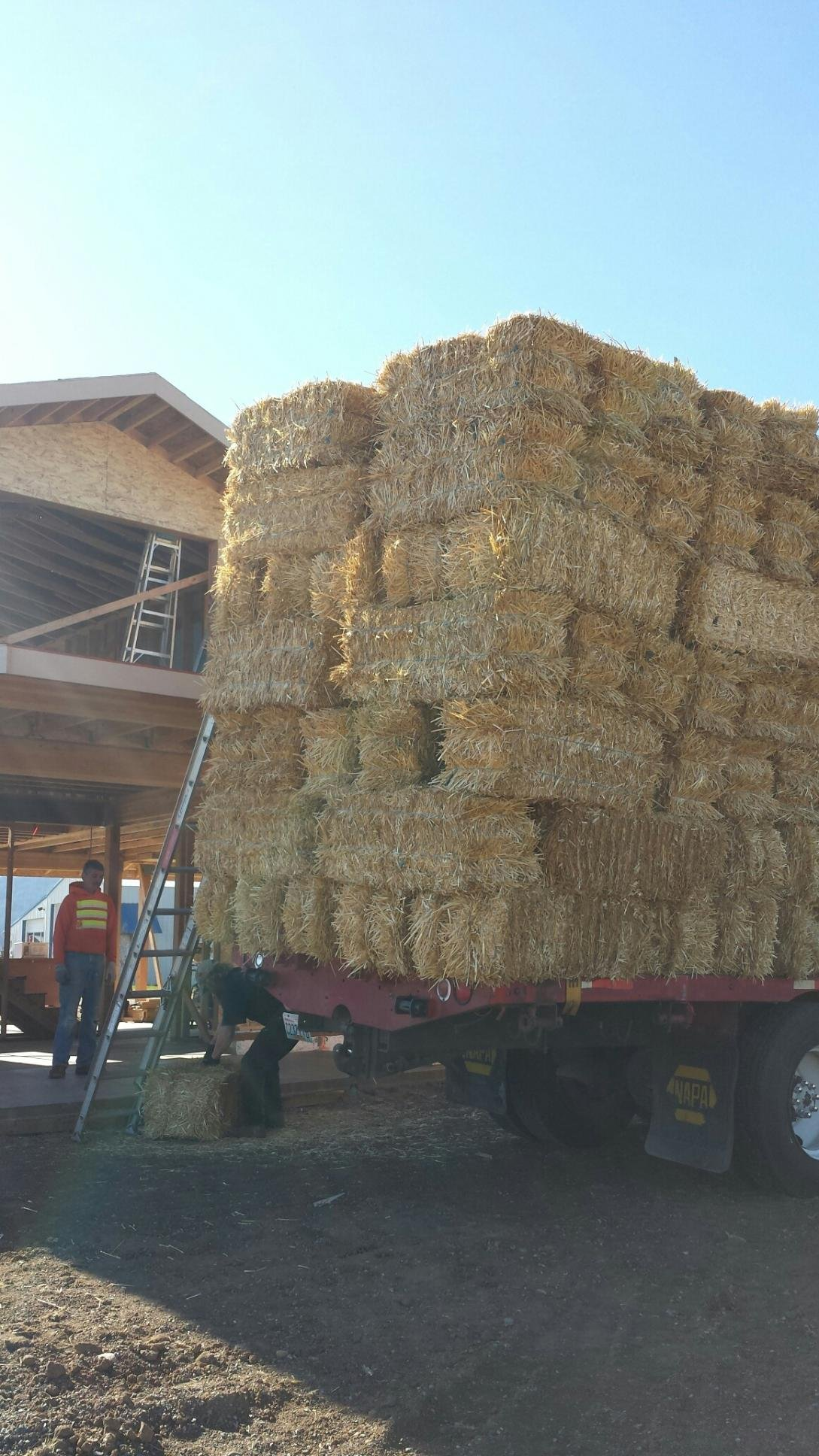 Straw Bales being dropped off at the Takaki's home