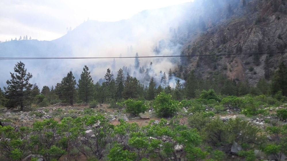 A 50 acre fire burning near Ribbon Cliff is being pushed by strong winds. Level two means there is a significant risk, you should either voluntarily move out of the area or be ready to leave at a moments notice.