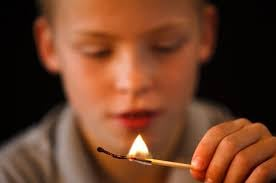 Child playing with fire (file)