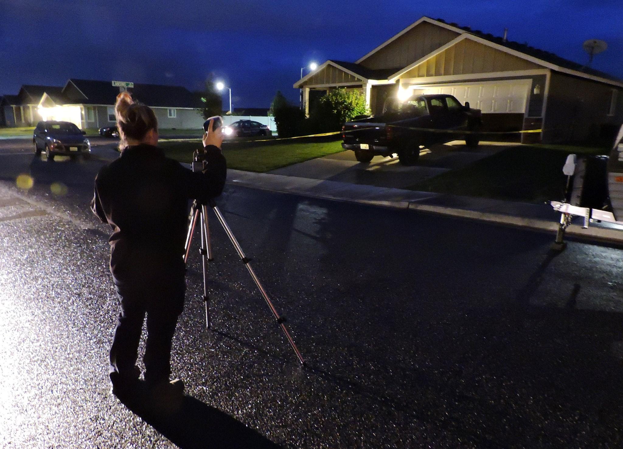 Evidence Tech, Ashley Wentz taking shots of the scene