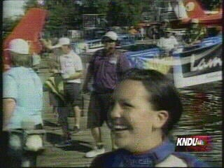 That's Kayleigh's fiancee in the purple shirt on the dock behind her