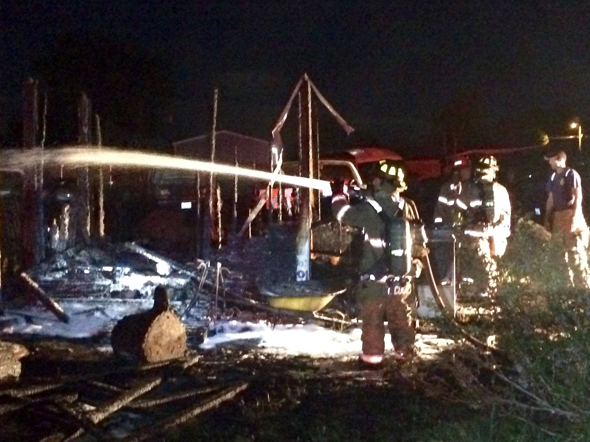 Firefighter putting out shed fire in Kennewick, Thursday night