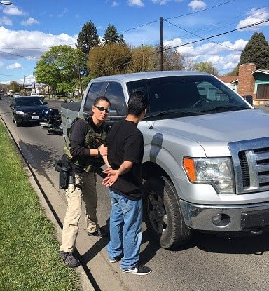 Police arresting suspect in shooting