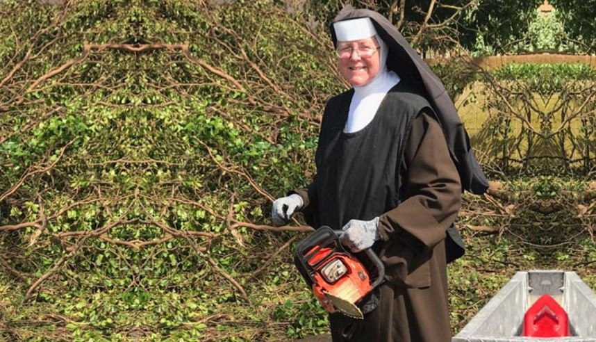 Nun gets stuck in to clear Hurricane Irma debris — Chainsaw MASS-acre