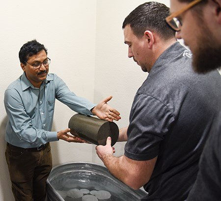 Srinivas Allena (left), WSU Tri-Cities clinical associate professor of civil and environmental engineering, discuss concrete testing methods.