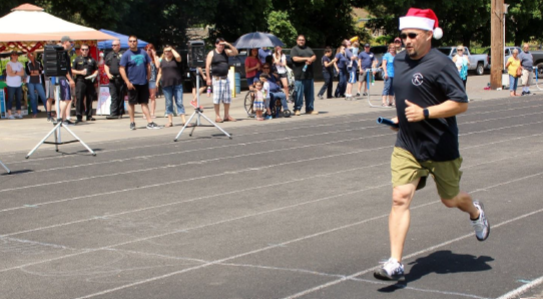 Washington State Penitentiary Superintendent Don Holbrook runs a leg for the DOC team