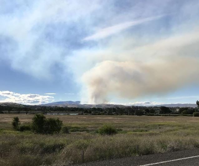 Law enforcement put 50 homes on evacuation notice and a shelter opened up at Naches Middle School. The fire threatened homes, crops, other buildings and power lines.