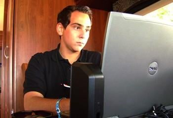 Aaron Hilf editing video at the Tri-Cities Waterfollies