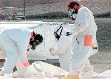 (AP Photo/Jackie Johnston, File). FILE -- In this March 23, 2004 file photo, workers at the tank farms on the Hanford Nuclear Reservation near Richland, Wash., measure for radiation and the presence of toxic vapors.
