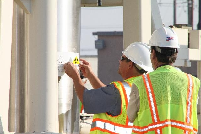 Workers prepare to ship radioactive sludge