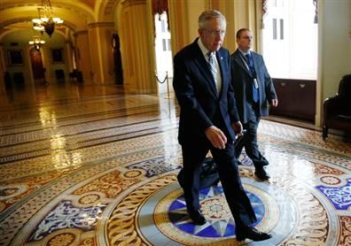 Sen. Harry Reid walks to his office Wednesday morning