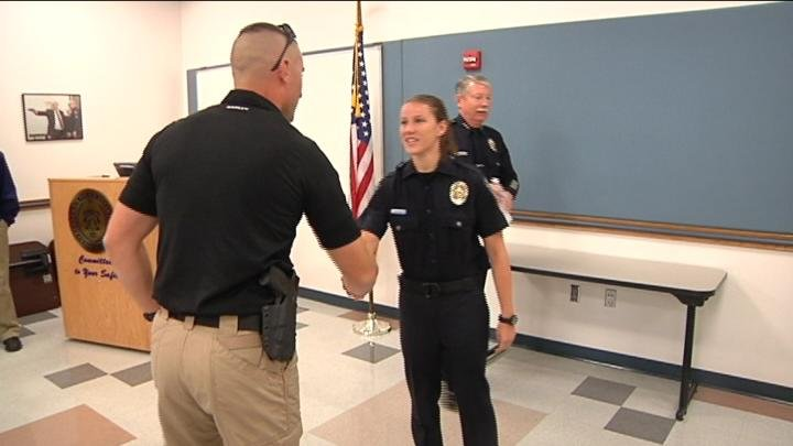 Fellow officers congratulate newest Kennewick Police Officer, Brooke Zimmerman.