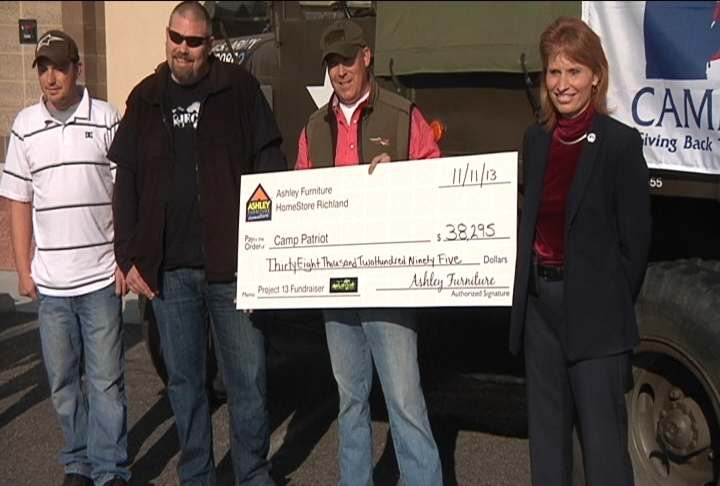 Project 13 volunteers donated big check Monday totaling more than $38,000 to Camp Patroit.