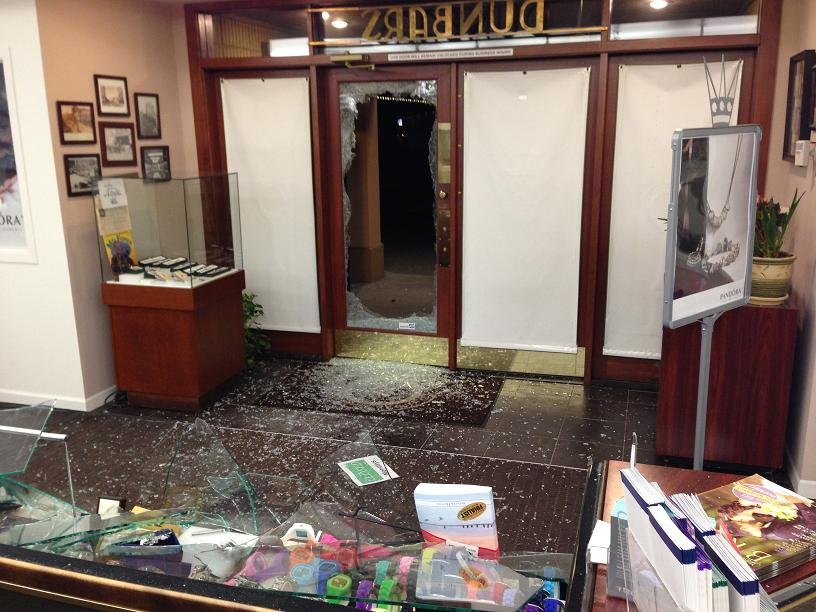 Dunbar Jewelers in Yakima is back open Wednesday after somebody rammed their car through the front gate and broke in.