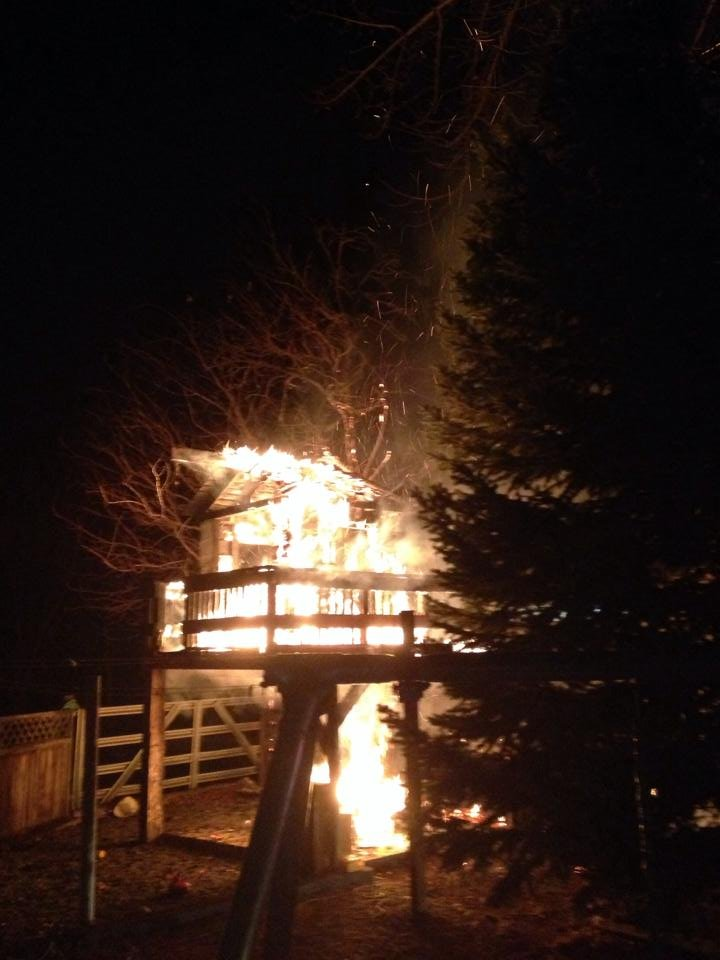 The fire at the wood shed spread to a nearby tree house Tuesday.