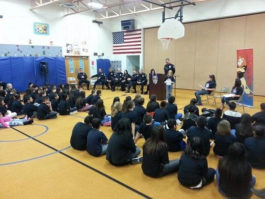 Fifth graders at Eastgate Elementary accepted their diplomas Wednesday morning for completing the D.A.R.E. program.