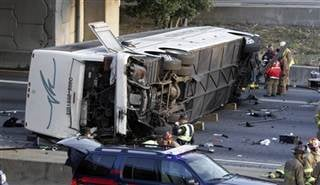 This March 2, 2007, file photo shows a charter bus carrying the Bluffton University baseball team from Ohio after it plunged off a highway ramp in Atlanta.
