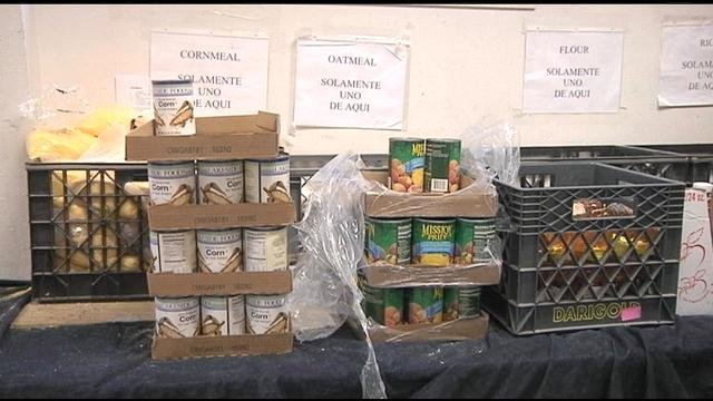 Record numbers of people are using local food banks this month and some attribute it to the recent reduction in federal food stamps.