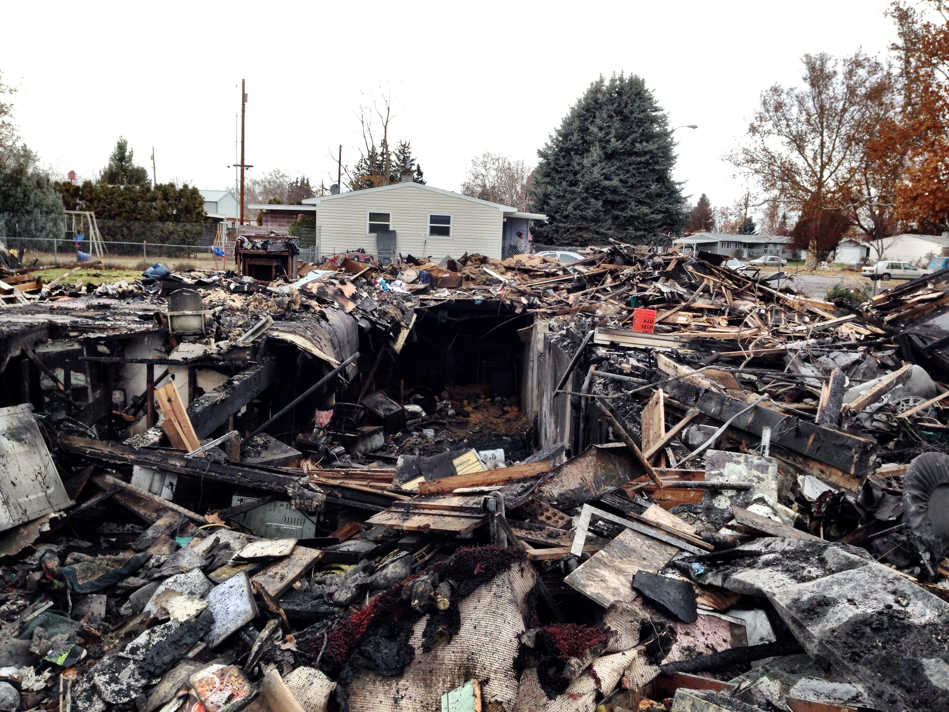 Crews were on Symons Street all Saturday long. After the fire was completely out, which took twelve hours in total, the site was bulldozed and the contents of the home scattered.