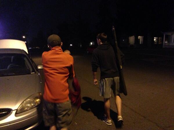 Gonzaga Students Dan McIntosh and Erik Fagan retrieve their guns from the Gonzaga Security building.