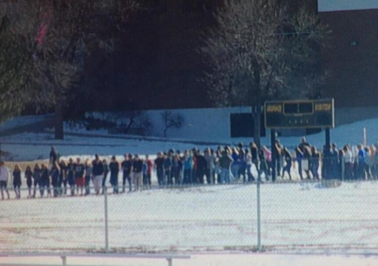 Arapahoe High School students outside after shots were reportedly fired.