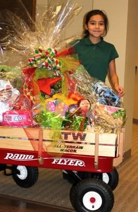 A fourth grader from Pasco is the winner of a red wagon filled with toys.