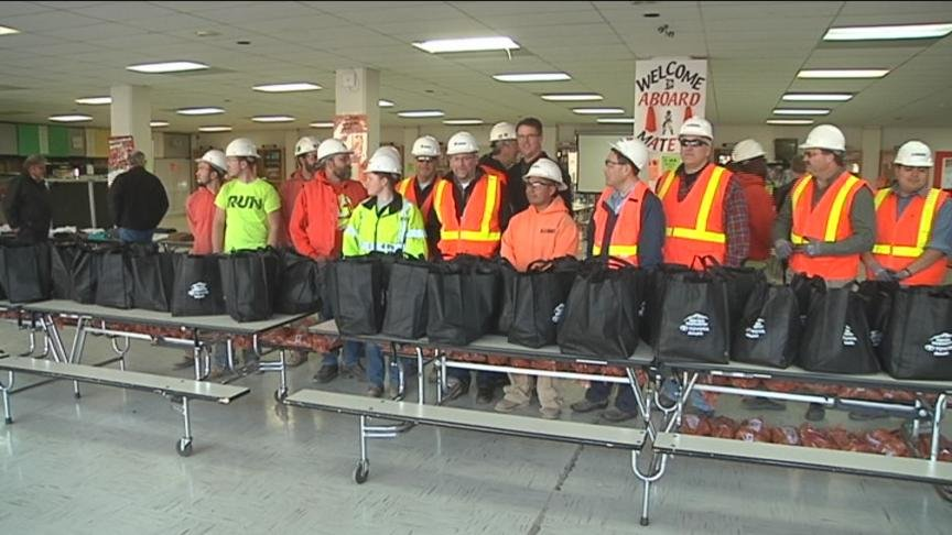 Construction workers at Davis High School in Yakima take a break from building and start giving.
