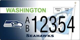 Specialized license plates for Seattle Seahawks and Sounders fans went on sale Thursday and football fans were especially eager.