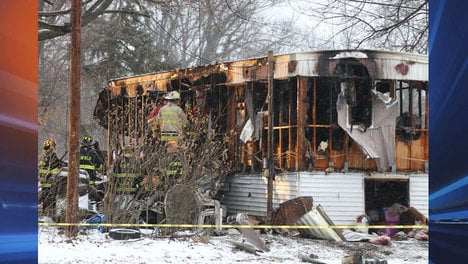 Courtesy: Jamie Germano, Rochester (N.Y.) Democrat and Chronicle -- Firefighters investigate a fatal fire in this mobile home in Penfield, N.Y. Three people died in the fire, Louis Beach, Steven Smith and 8-year-old Tyler Doohan.