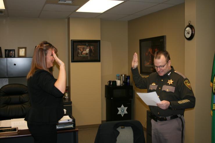Sheriff Steve Keane swears in Deputy Natalie Griffin