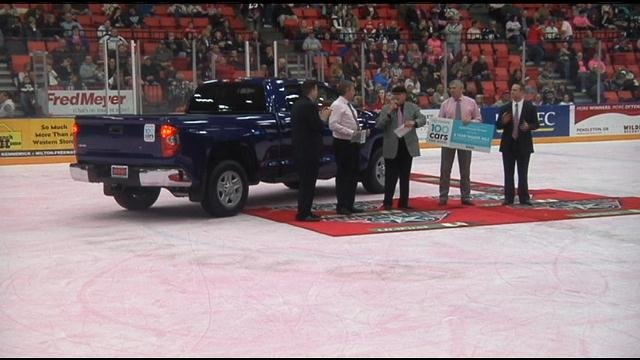 During the first intermission of the Tri-City Americans' game Friday, Toyota of Tri-Cities presented a new 2014 Toyota Tundra to Habitat for Humanity Tri-Cities.