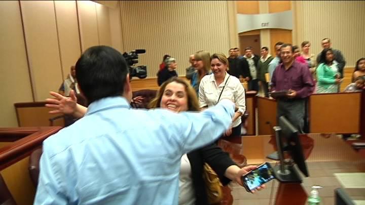 Fernando Maldonado, a new US citizen, is about to get a congratulatory hug.