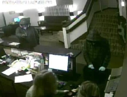 Pasco police are looking for two men accused of robbing the Sleep Inn along Bedford Street.