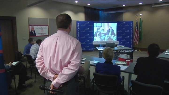 Chris Cargill with the Washington Policy Center watches Olympia video conference in Tri-Cities.