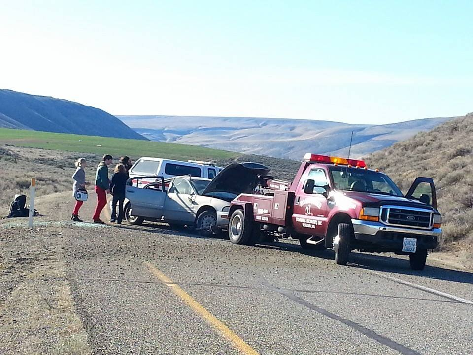 Four band members walk away after car rolls along I-82 near Richland.