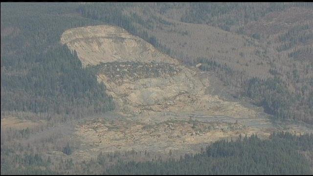 Washington state officials say searchers have recovered two bodies and believe they have located another eight in the debris of a massive landslide.