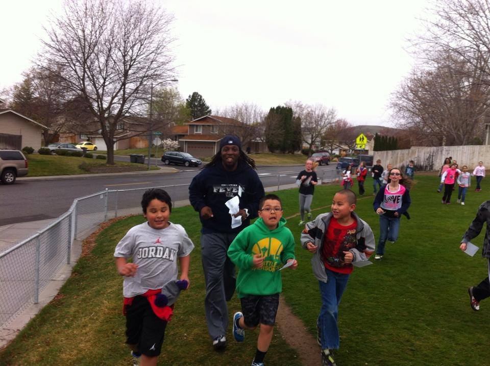 The students at Sunset Elementary School ran between the rain drops at Friday's Running with Our Heroes Jog-O-Thon.