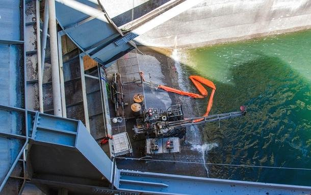 Drilling work is continuing at Wanapum Dam as crews continue to examine a 65-foot fracture found in a spillway pier in February.