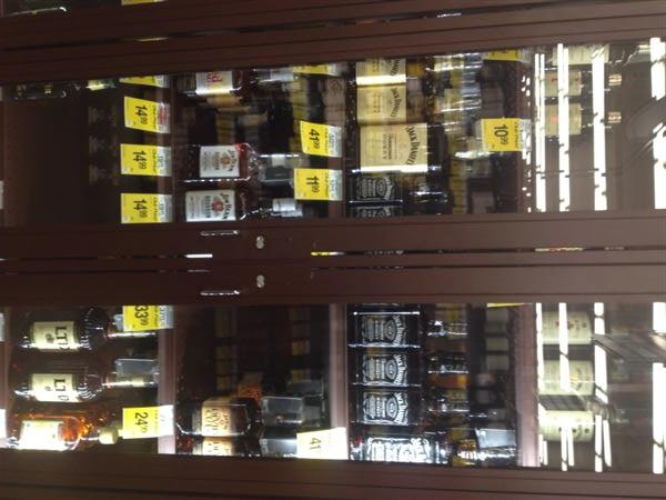 Both Walla Walla Safeway stores are encasing their liquor merchandise behind locked glass doors to minimize the theft of spirits.