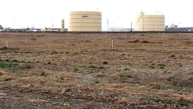 The investigation continued Tuesday after Monday's pipeline explosion at the Williams Natural Gas Facility