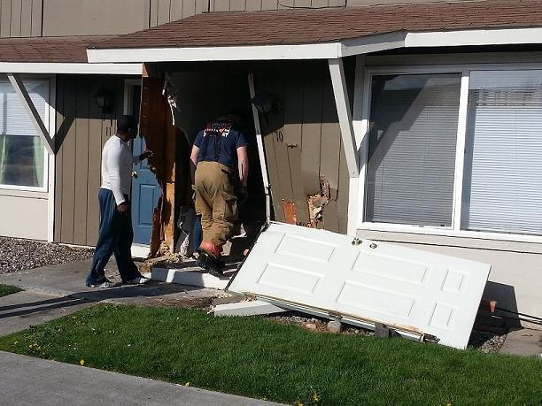 A Kennewick woman is doing okay after driving her car into her own apartment Monday morning.