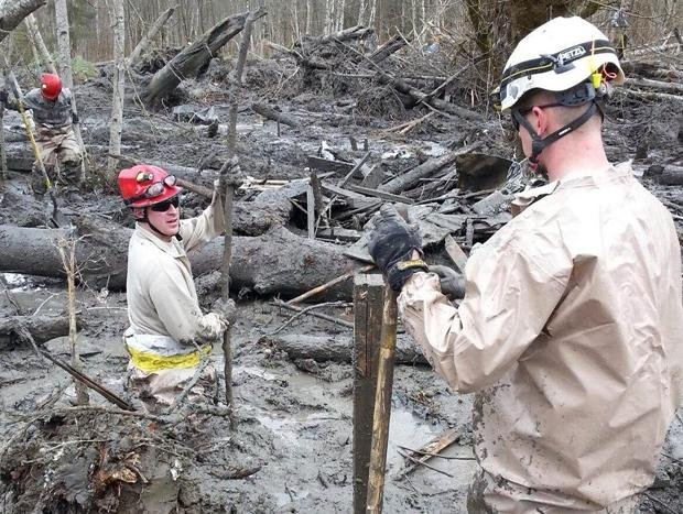 The death toll from the mudslide that hit the Washington town of Oso has risen to 37.