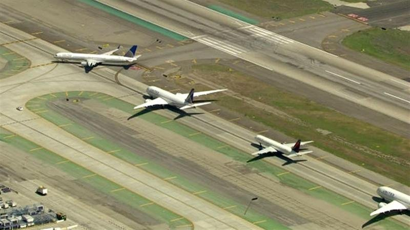 Officials at the Seattle-Tacoma International Airport say passengers can expect a domino effect from technical problems at Los Angeles-area airports.