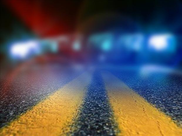 Log truck crashes with car, killing driver.