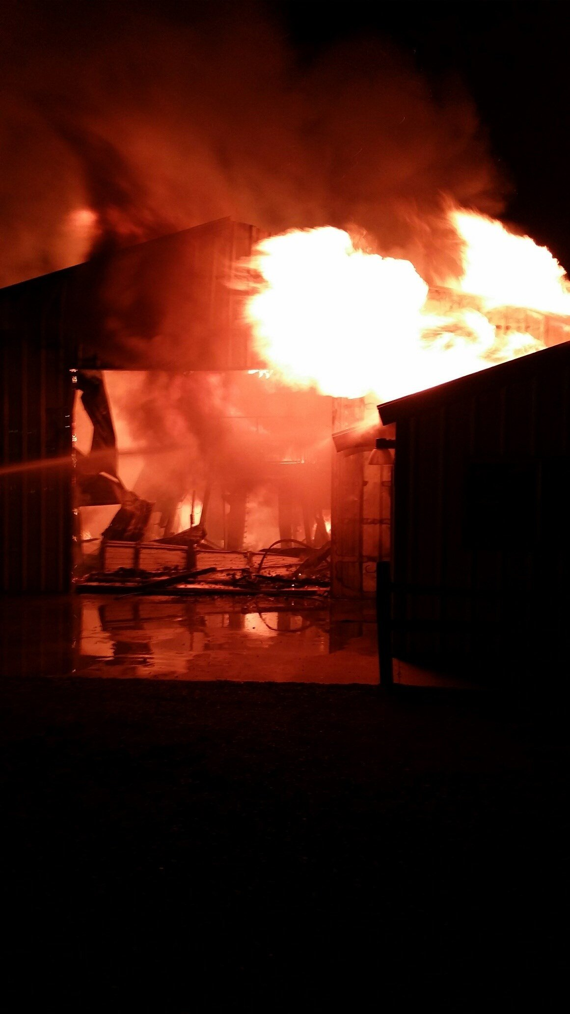 An overnight fire near Grandview on Sunday could cost the owners of a farm equipment shop over one million dollars.