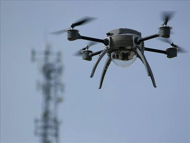 Federal regulators say they've granted the first permission for commercial drone flights over land.